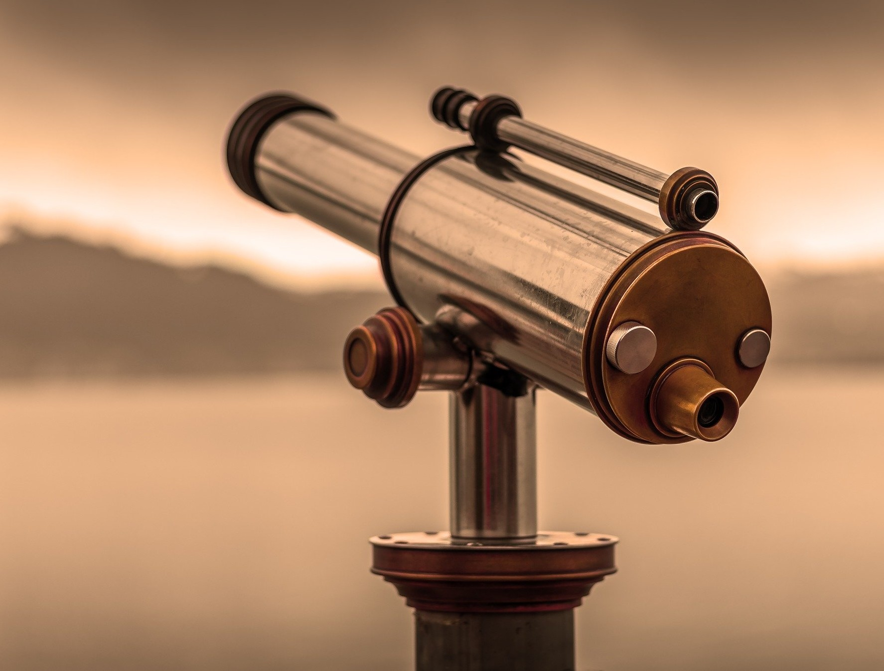 telescope pointed towards mountains