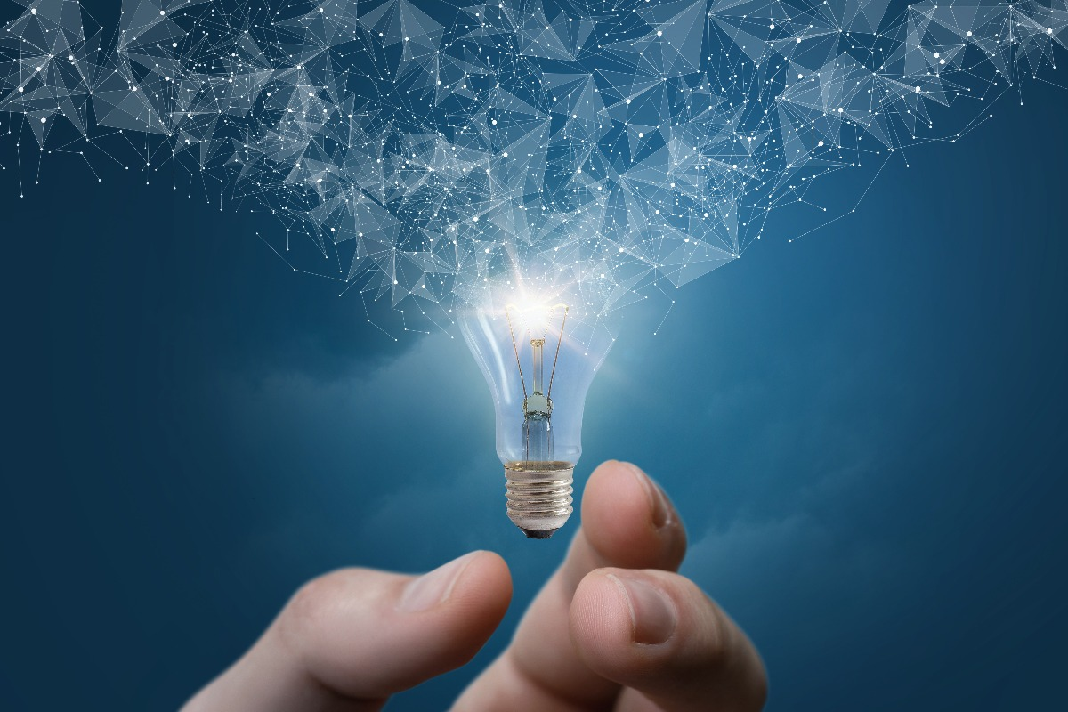 hand touching light bulb